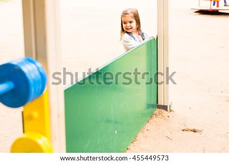 little girl on the summer playground - stock photo