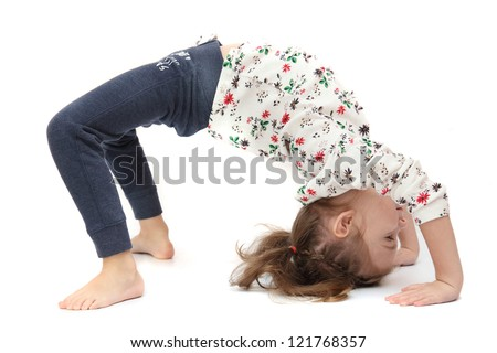 Little girl on yoga - stock photo