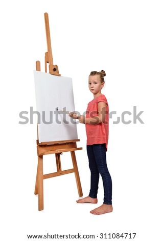 little girl painting on a blank easel - stock photo
