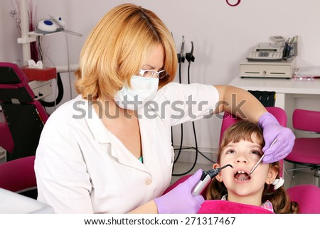 little girl patient and dentist - stock photo