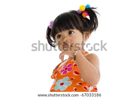 Little girl picking her nose, isolated on white background - stock photo