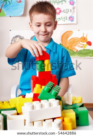 Little girl play construction set . - stock photo