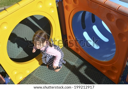 Little girl play in modern children toy playground in park. - stock photo