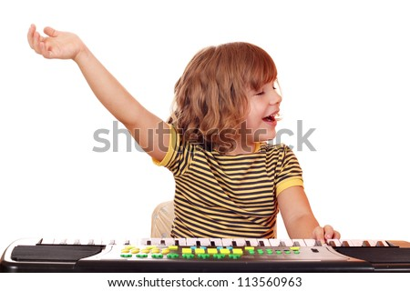little girl play music on keyboard - stock photo