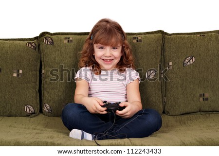 little girl play video game - stock photo