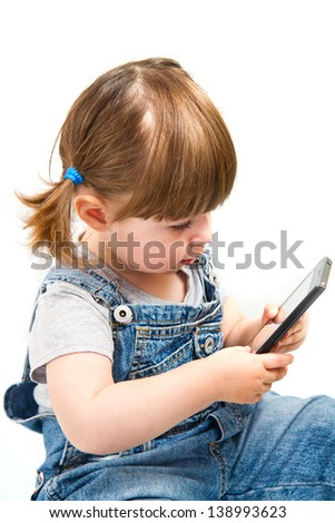 little girl play with mobile phone on white background - stock photo