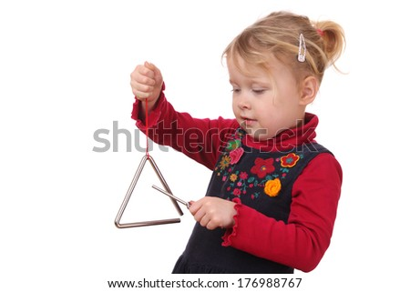 Little girl playing a triangle instrument on white background  - stock photo