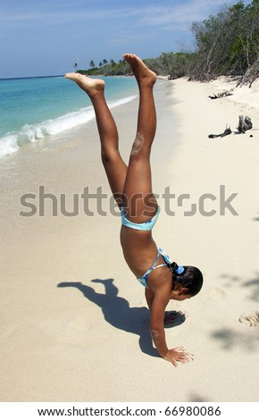 Little girl playing at the beach. - stock photo