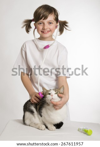 little girl playing at the vet - stock photo