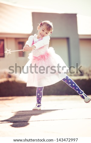 Little girl playing dress ups as a fairy - stock photo