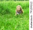 little girl playing in a field - stock photo