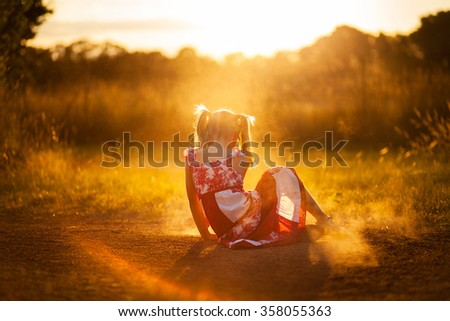 little girl playing in the dust - stock photo