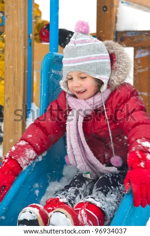 Little girl playing in winter time. - stock photo