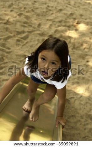 little girl playing on playground - stock photo