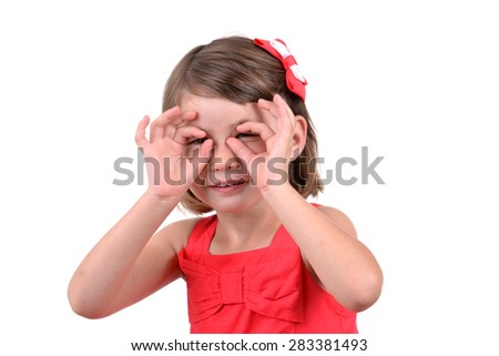 little girl playing peek a boo isolated on white background - stock photo