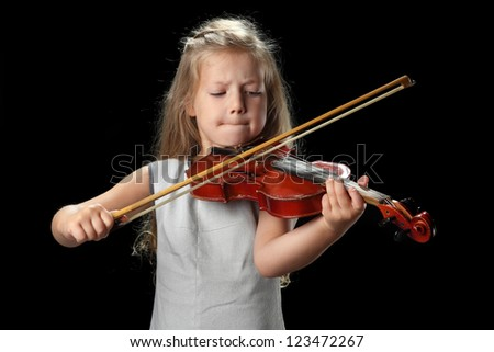little girl playing the violin - stock photo