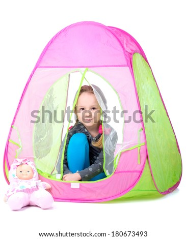 Little girl playing toy tent. Isolated on white background - stock photo