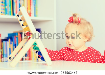 little girl playing with abacus, early learning - stock photo