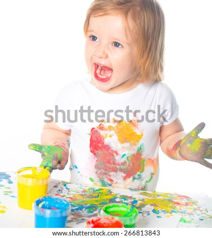 Little girl playing with paints - stock photo