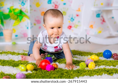 little girl playing with toy balls - stock photo