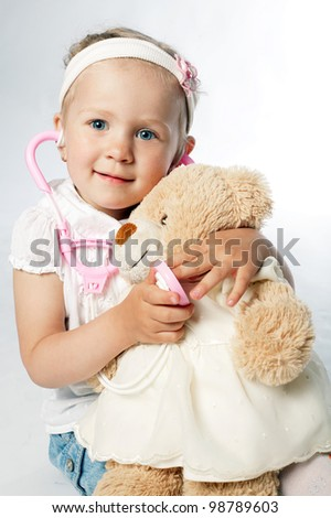 little girl plays doctor - stock photo