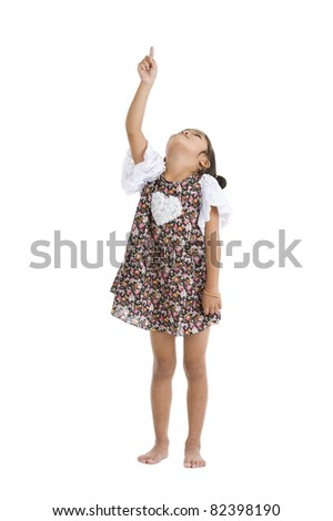 little girl pointing and looking up, isolated on white background - stock photo