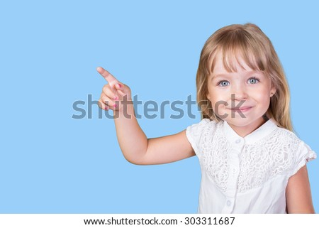 Little girl pointing finger - stock photo