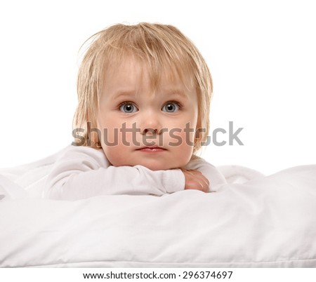 Little girl portrait on bed with white background - stock photo