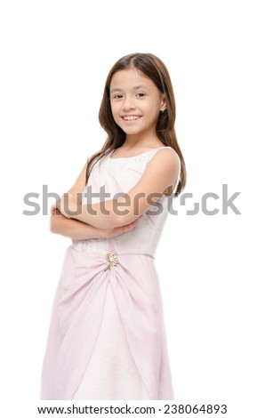 Little girl portrait on pink dress smiling on white background - stock photo