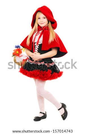 Little girl posing dressed as little red riding hood with basket. Isolated on white  - stock photo
