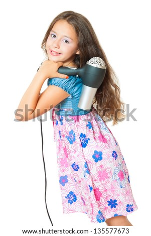 little girl posing with hair dryer isolated on white - stock photo