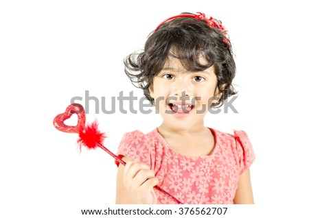 Little girl posing with love symbol isolated in white background - stock photo