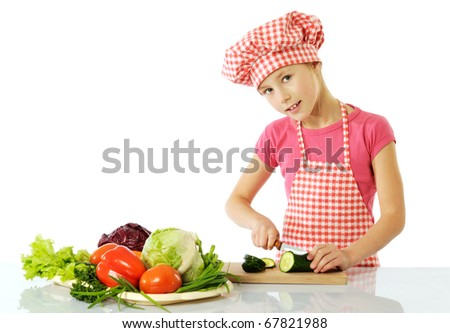 Little girl preparing salad - stock photo