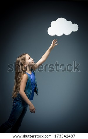 Little girl reaching for bubbles - stock photo