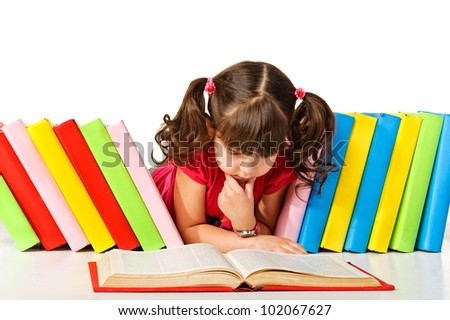 little girl reading a book on the floor. Isolated on white background - stock photo