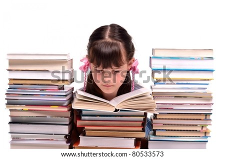 Little girl reading a book sitting among stacks of books isolated on white background - stock photo