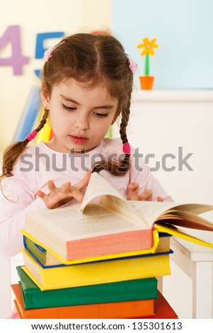 little girl reads,preschool education - stock photo