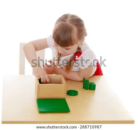 Little girl running with figures in Montessori kindergarten-Isolated on white background - stock photo