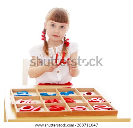 Little girl running with the letters in Montessori kindergarten-Isolated on white background - stock photo
