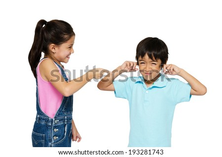 Little girl shouting at little boy on white background - stock photo