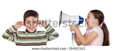 Little girl shouting through megaphone at a boy isolated over white - stock photo