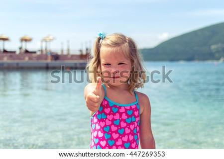 little girl showing OK sign - stock photo