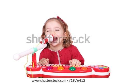 little girl sing and play music - stock photo