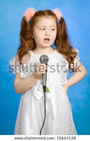 Little girl singing Isolated on white background - stock photo