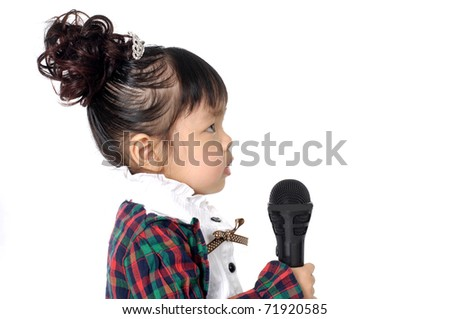 Little girl singing with microphone on white - stock photo