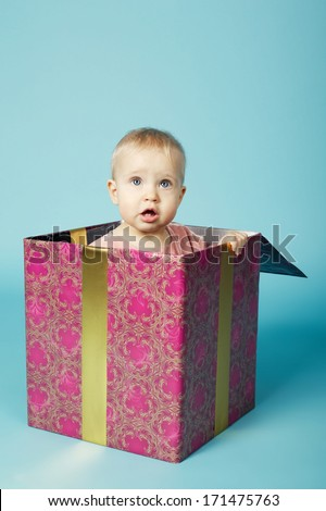 little girl sitting in box - stock photo