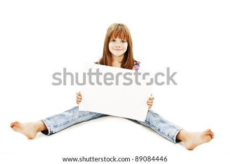 Little girl sitting on floor showing advert.  Isolated on white background - stock photo