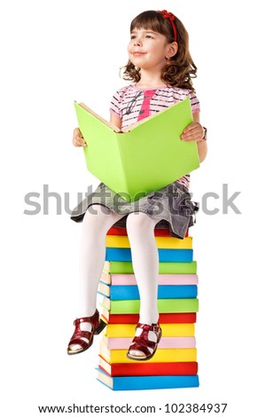 Little girl sitting on stack of books. Isolated - stock photo