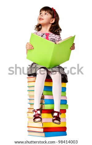 Little girl sitting on stack of books. Isolated over white - stock photo