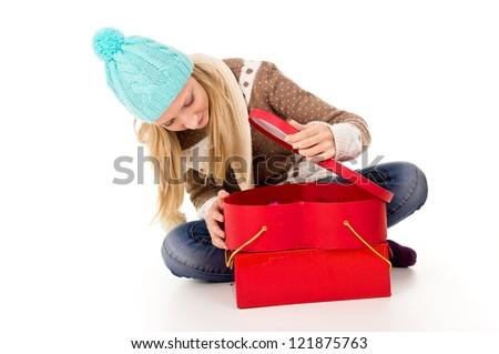 little girl sitting on the floor with gifts - stock photo